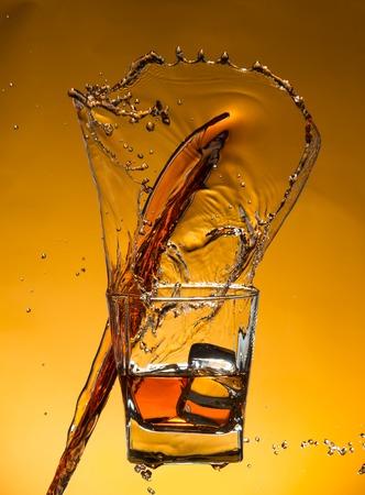 sherry: Whiskey with ice with liquid splash, freeze motion.