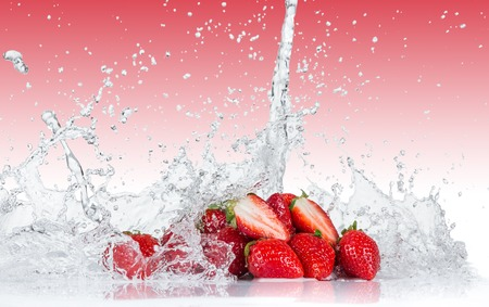 fruit in water: Fresh Strawberries with water splash over white background