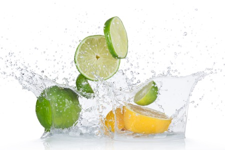 lime green background: Limes and lemons with water splash isolated on white