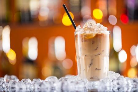 Ice coffee on bar desk, close-up. photo