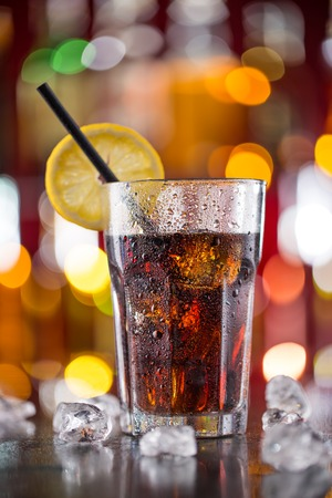 cool: Glass of cola on bar desk, close-up. Stock Photo