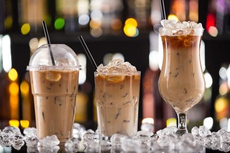 Ice coffee on bar desk, close-up.