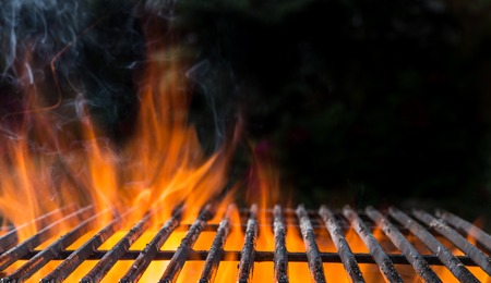 grate: Cast-iron grate with fire flames Stock Photo
