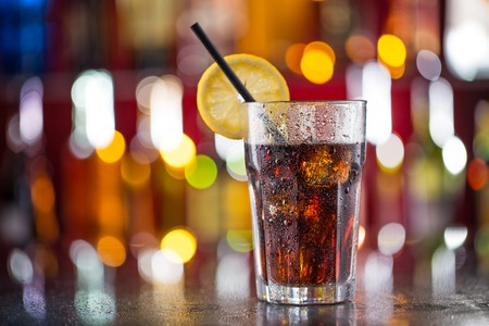 fizzy: Glass of cola on bar desk, close-up. Stock Photo
