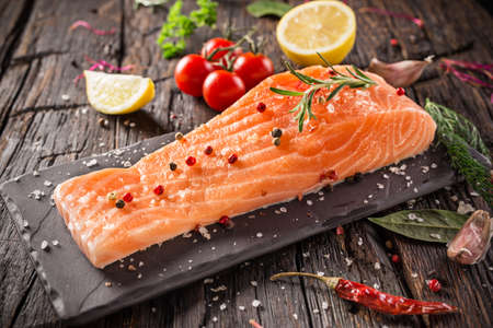 red  stone: Delicious salmon steak on wooden table, close-up
