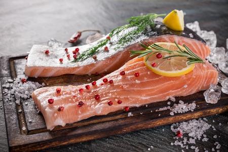 mignon: Delicious salmon steak on wooden table, close-up