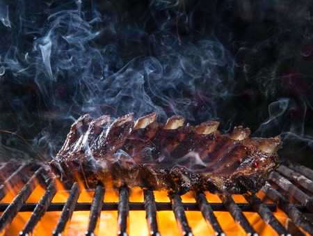 grate: Delicious pork spareribs on cast-iron grill grate Stock Photo
