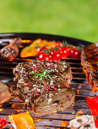 Delicious meats on garden grill, barbecue time. photo
