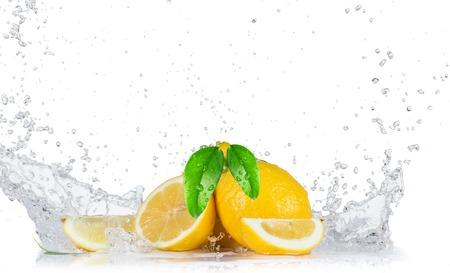 Lemons with water splash isolated on white Stock Photo
