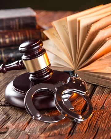 auctioning: Wooden gavel and books on wooden table, law concept Stock Photo