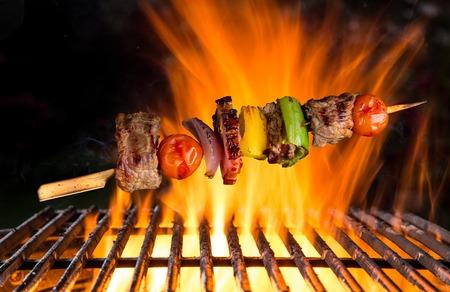 rump steak: Tasty skewer with cast-iron grate. BBQ Stock Photo