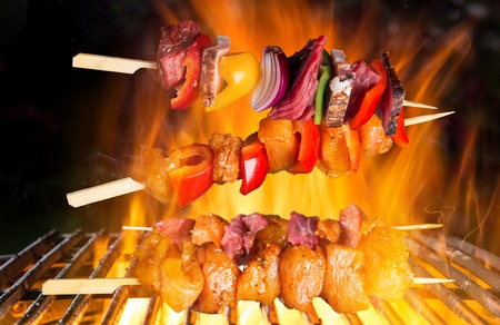 chicken fillet: Tasty skewers on cast-iron grate. Stock Photo