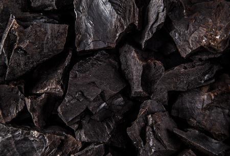carbon emission: Coal lumps on dark background closeup Stock Photo