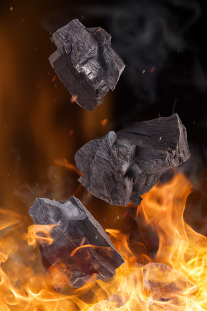 coal fire: Coal lumps with fire flames, close-up Stock Photo