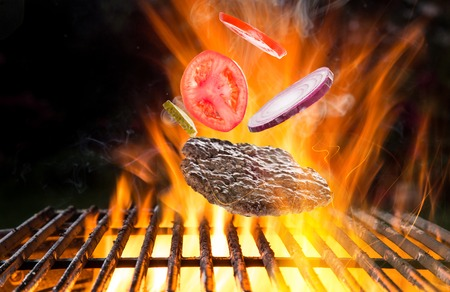 Tasty meat on cast iron grate Stock Photo