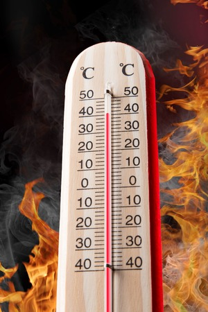 extreme heat: Celsius thermomether with fire flames