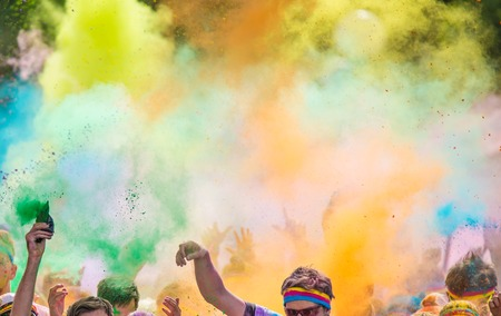 run woman: Close-up of marathon, people covered with colored powder. Stock Photo
