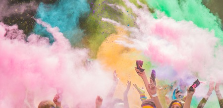 Close-up of marathon, people covered with colored powder. Stock Photo