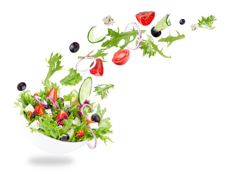 fresh vegetable: Fresh salad with flying vegetables ingredients isolated on a white background.