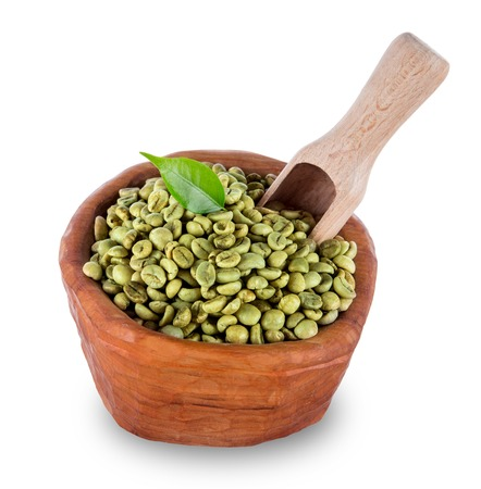 unroasted: green coffee beans in wooden bowl, close-up. Stock Photo