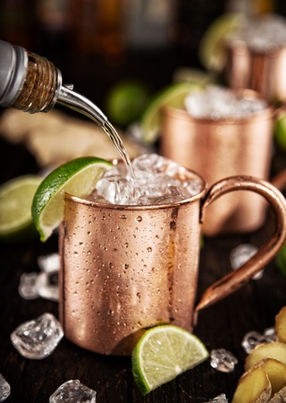 Cold Moscow Mules - Ginger Beer, lime and Vodka on bar Stock Photo