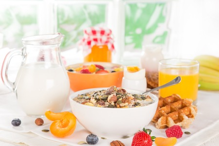 corn flower: Healthy breakfast with muesli, fruit, tea and berries
