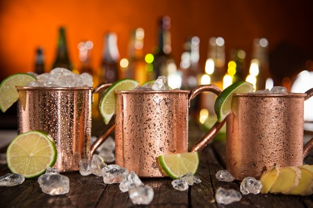 mules: Cold Moscow Mules - Ginger Beer, lime and Vodka on bar Stock Photo