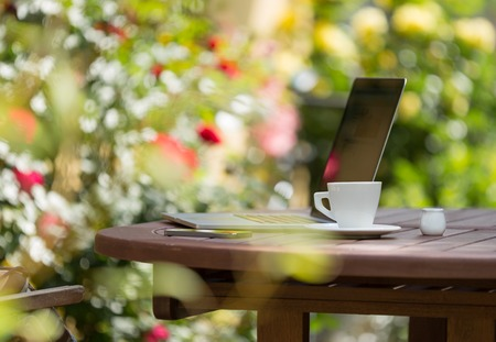 Notebook on the garden, working outside.