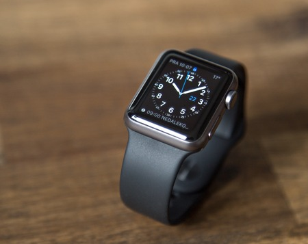capabilities: PRAGUE, CZECH REPUBLIC - June 22, 2015: New wearable Apple Watch smartwatch displaying the Home screen. Apple Watch has fitness tracking and health-oriented capabilities with iOS products.