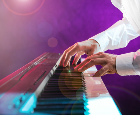 pianist: Close-up of pianist playing the piano. Stock Photo