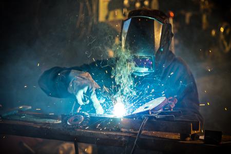 welder: Welder in action with bright sparks