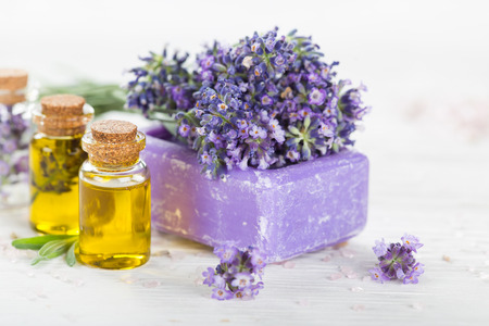 therapeutic: Wellness treatments with lavender flowers on wooden table Stock Photo