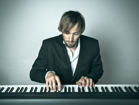 piano player: Close-up of pianist playing the piano. Stock Photo