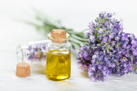 Wellness treatments with lavender flowers on wooden table Stockfoto