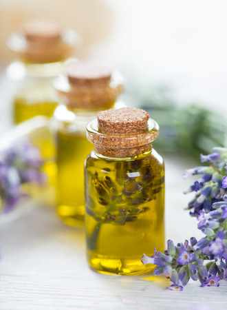 Essentials oils with lavender flowers Фото со стока