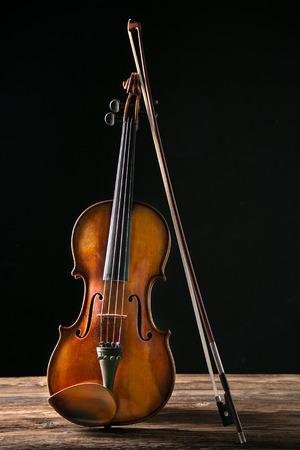 stradivarius: violin in vintage style on dark background Stock Photo