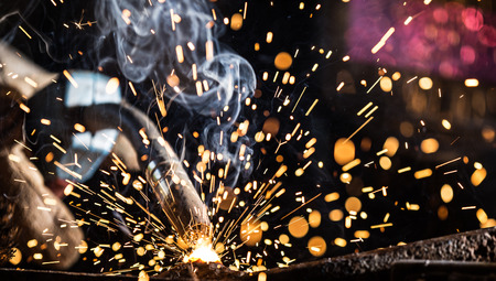 Bright sparks of Construction and manufacturing Stock Photo