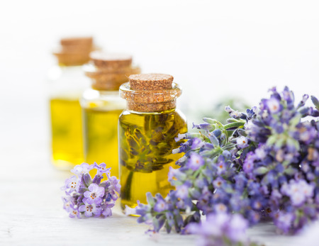 Essentials oils with lavender flowers Stock Photo