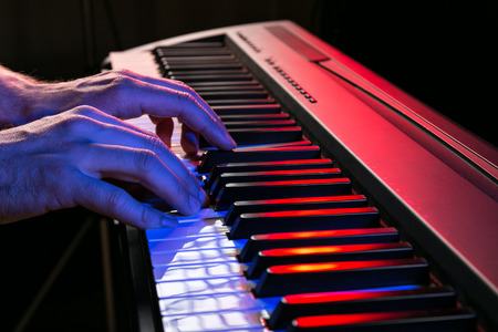 keyboard player: Close-up of pianist playing the piano. Stock Photo