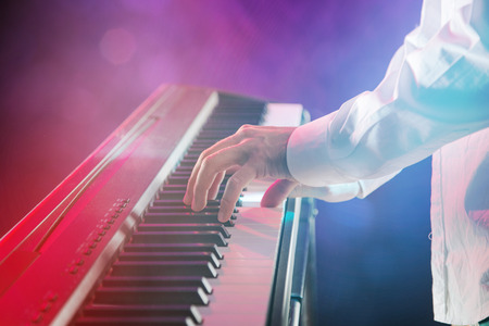 piano: Close-up of pianist playing the piano. Stock Photo