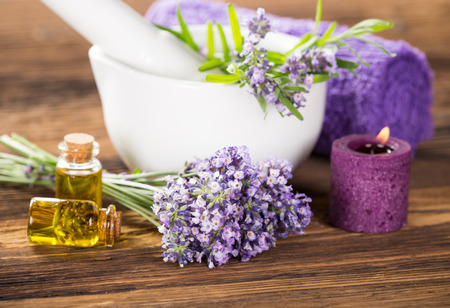 Wellness treatments with lavender flowers on wooden table. Spa still-life.