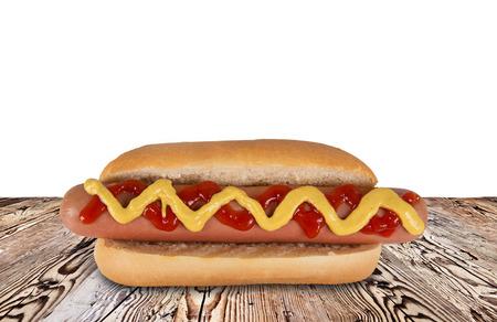 hotdog: hot dog on wooden background, close-up.