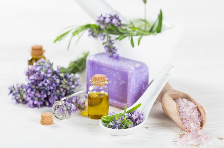 aroma: Lavender flowers with essential oil, close-up.