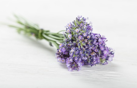 body care: Lavender flowers on wooden table, close-up.