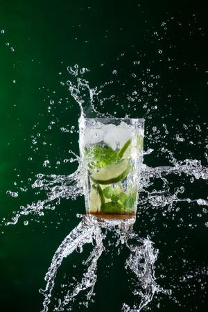 liquid splash: Mojito drink with splash, close-up. Stock Photo