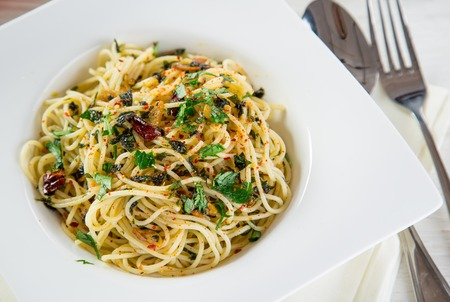 olio: Italian pasta aglio olio, close-up.