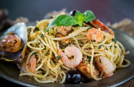 olio: Italian pasta aglio olio frutti di mare, close-up.