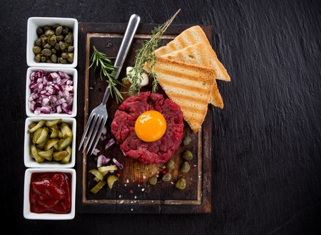 mini: Close up of beef tartar with capers and small toasts. Stock Photo