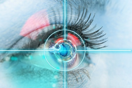 science background: Woman eye scan interface, close-up.