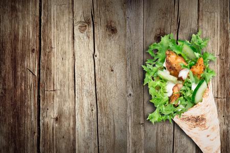 tortilla: Tortilla chicken wrap sandwich, close-up.